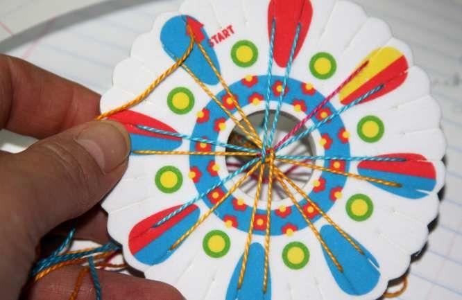 Tutorial on how to weave button friendship bracelets. Visit RachelArmington.com for more kid crafts.