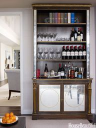 an antique bookcase as a bar in a Manhattan apartment by Phoebe and Jim Howard // bar design