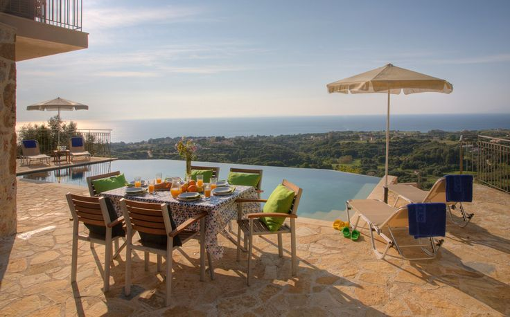 """Three sets of patio doors lead out to the pool terrace and """"al-fresco"""" dining area."""