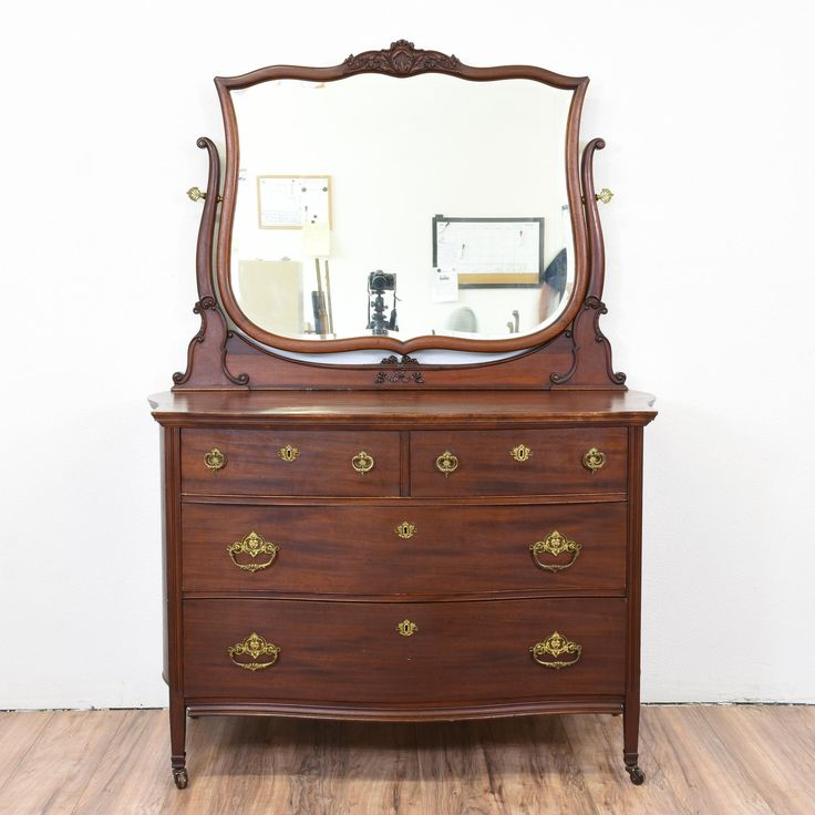 This gorgeous antique dresser is made of mahogany wood. The Victorian dresser is set on casters for easy moving. The dresser has a detachable vanity mirror. Intricate carved detailing graces the wood. There is some wear on the piece. #victorian #dressers #vanitydresser #sandiegovintage #vintagefurniture
