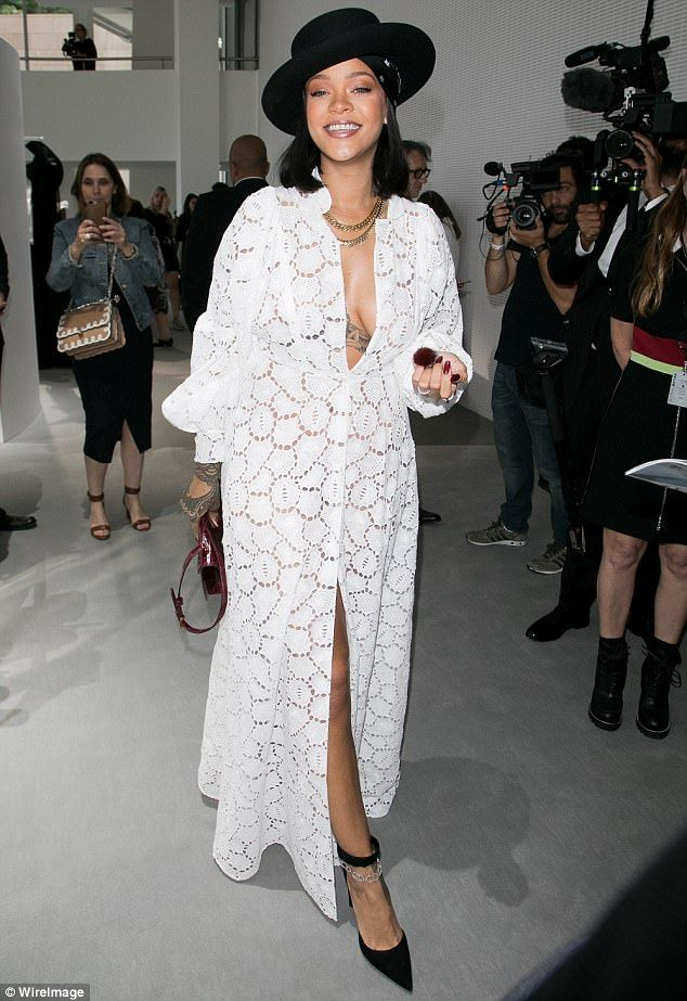 Overjoyed: Rihanna looked delighted to be part of the fashion event. White long dress, black hat, June 2017