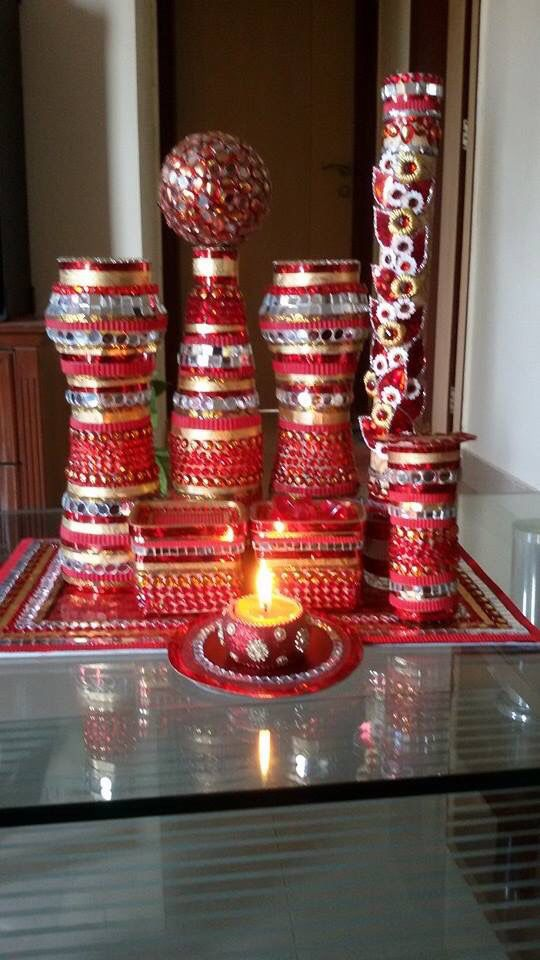 bottle, diya, stand decorated with red
