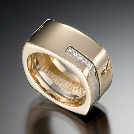 Substance and style.  The Quattro men's ring features clean lines of 14kt yellow gold with white gold accent, featuring .08 carats total of VS G diamonds. Priced at $3,980. This unique ring design features simple, clean lines of with two tones of gold and diamonds. Call (949) 715-0953 to purchase or click below for additional information.