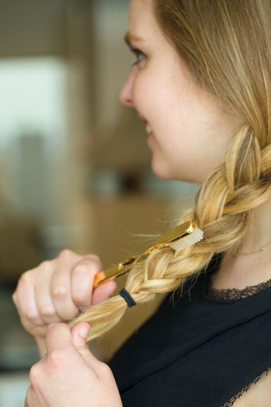 Hair hack: brush a toothbrush in upward motions on your braid to create texture for the perfect messy braid.