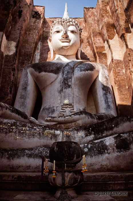 giant Buddha statue, Phra Achana at Wat Si Chum in the Sukhothai Historic Park in Thailand | Darby Sawchuk