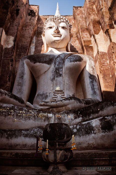 giant Buddha statue, Phra Achana at Wat Si Chumin the Sukhothai Historic Park in Thailand   Darby Sawchuk