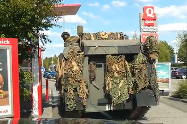 A Belgian Military Tank Drives Through a Fast Food Restaurant Drive-Thru To Order Food