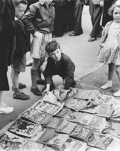 Credit: Bob Collins/Museum Of London  Children gather around a pile of comics for sale at Romford Market, 1947