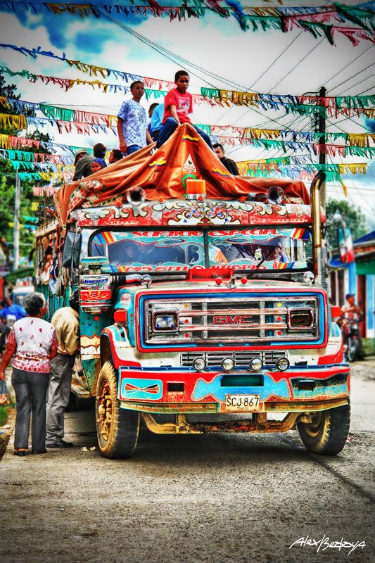 "Old buses full of color and joy, transporting people, food, animals and goods from one town to another in the Colombian countryside ""Chiva"" - Bus escalera Cauca-Colombia by Alex Bedoya"