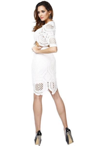 7b7b216da79 A stunning white lace two-piece dress with a bandage skirt and top. The lace  overlay is feminine with glimpses of skin. The short midriff and  half-length ...