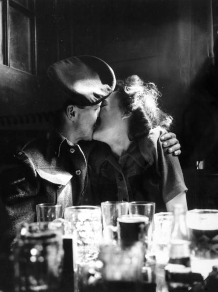 8th May 1945: A couple in a pub, somewhere in London. (Photo by Popperfoto/Getty Images)