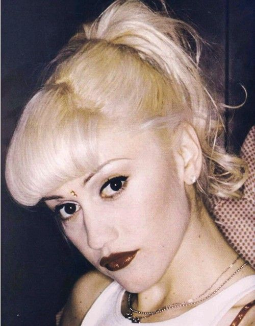 When Gwen Stefani first broke onto the scene with No Doubt, her mixture of punk rock and vintage looks, combining her short bangs with vibrant blonde color and a bright red lip. Description from blog.salonbuzz.com. I searched for this on bing.com/images