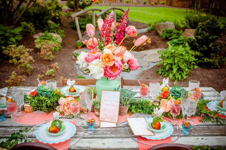 Pretty peach and pink florals, succulents, and fresh peaches with a little shabby chic and bohemian flair blend together flawlessly for a wedding look that's perfect for spring.  | Lush Floral Table Decor | Peach Boho Wedding Inspiration |  Heather Lynn Photographie