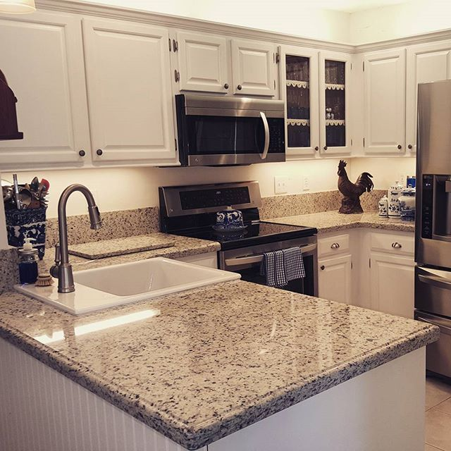 Beautiful Kitchen With Dallas White Granite Counter Tops