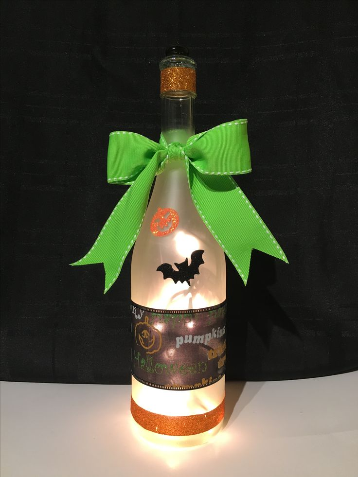Repurposed wine bottle decorated with a Halloween