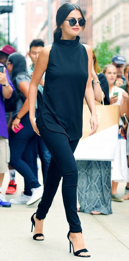 Look of the Day | InStyle.com Selena Gomez pieced together the perfect in-between weather ensemble with a black high-neck sleeveless tunic (aka the best transitional piece) and styled it with black 3x1 skinnies, aviators, and black ankle-cuff sandals.