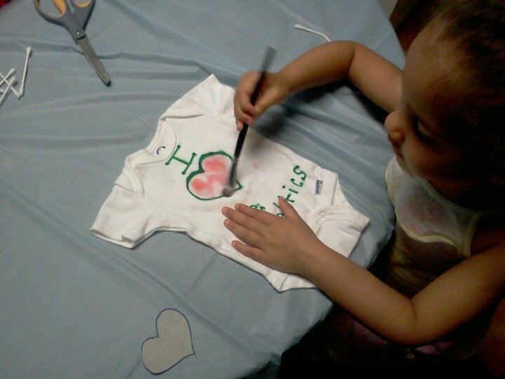 Before my son was born,got the girls involved by decorating plain onesies w/ paint, markers etc.Great keepsake and also fun idea for baby shower activity!