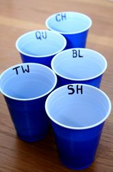 Toss something into the cup and come up with with a word that starts with those letters