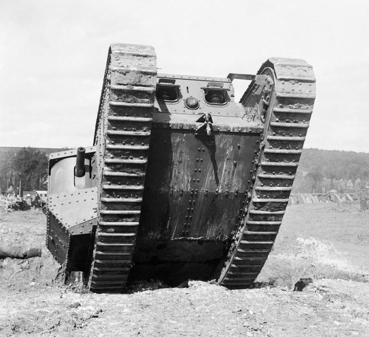 TANK WARFARE DURING FIRST WORLD WAR (Q 11662)   A Mark IV tank on the testing ground at Tank Corps Central Stores, Erin. The photograph is taken looking at the front of the tank as it rears up to cross an obstacle. The driver is clearly visible through the flap.