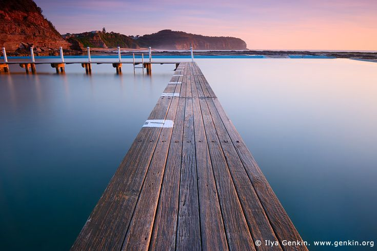 Early Morning at Narrabeen Tidal Pool, Narrabeen Beach, Sydney, NSW, Australia. Stock image of calm waters at Narrabeen Tidal Pool on famous Sydney's Northern Beaches in NSW, Australia early in the morning just after Sun got above horizon.