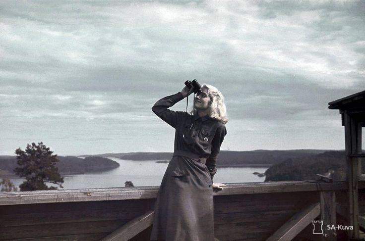 Lotta Svärd volunteer Ellen Kiuru posing at an air raid warning post in Lahdenpohja, Finland. 1942.