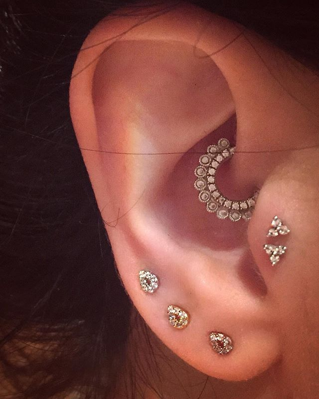 An impeccably designed ear, with the focus falling on the eye-catching Cubic Zirconia Apsara Clicker || Shop this look from @maria_tash