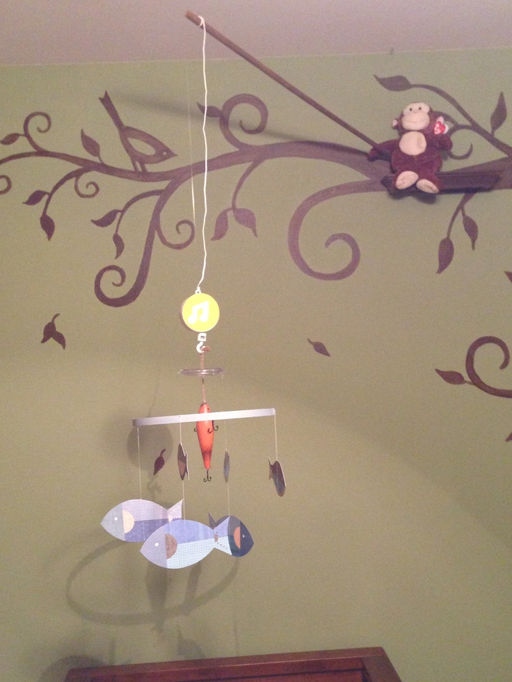 Fishing Monkey nursery theme.  Monkey on the shelf with the fish mobile over the crib! My own design to incorporate my love if monkeys and my husband's love of fishing - love the way it turned out!