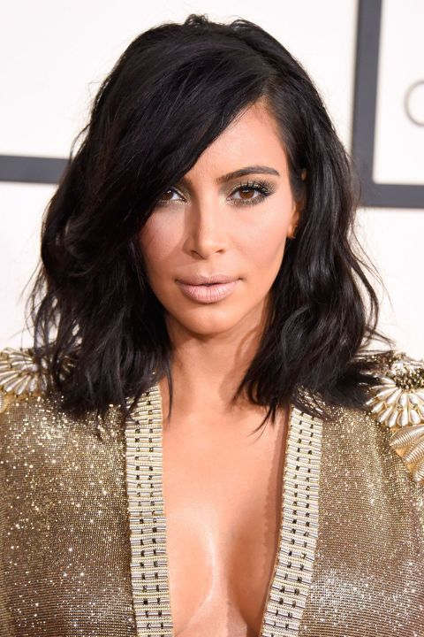 Kim Kardashian is the latest celebrity to cut her hair into a bob, debuting a shorter, textured look at the Grammy Awards 2015.  Getty Images