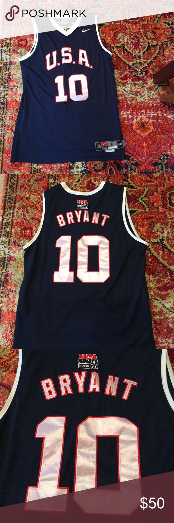 Mens large Nike Kobe Bryant Olympic jersey Mens large Nike Kobe Bryant USA Olympic jersey. All numbers, letters, and patches are stitched. This is the game model. Looks like the letters and numbers have slight bleeding from the red stitching. Please let me know if you have any questions. Thanks Nike Shirts Tank Tops