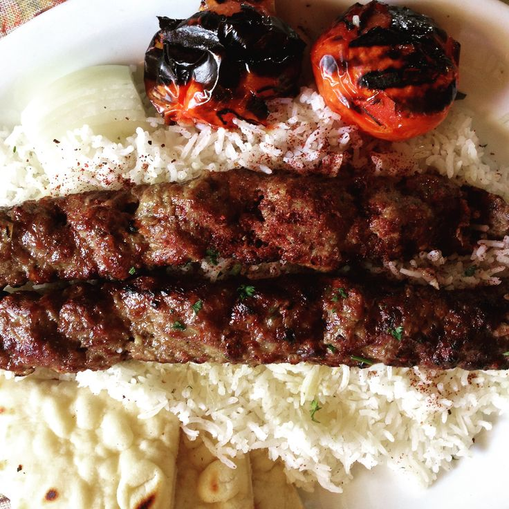 Chelo Kabob is a simple meal! Grilled minced meat and onions served over fluffy Persian rice, but it is spectacular and unforgettable nonetheless!