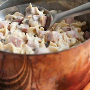 Sure to become a family favorite, this quick cooking casserole combines cubed cooked ham, noodles and tender onions blended with a creamy cheesy sauce.