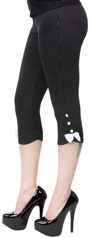 SOURPUSS POLKA DOT CAPRI LEGGINGS  Sourpuss has a pair of capris perfect for any pinup! These black capri leggings feature an all over polka dot pattern with decorative bows & buttons down each side.  $32.00