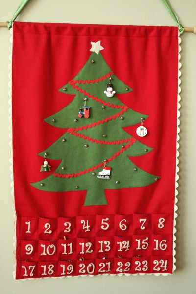 Fabric Advent Calendar. We made one of these, and a snowman version last year! Really lovely presents!