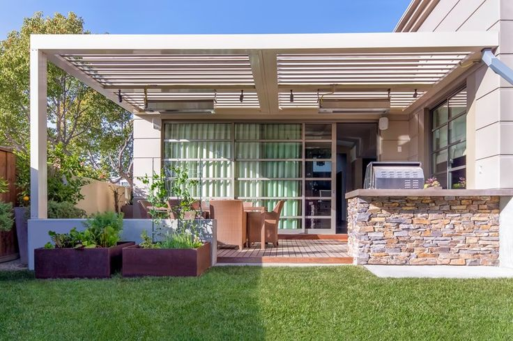 Attached Metal Patio Cover Pergola and Patio Cover Studio H Landscape Architecture Newport Beach, CA