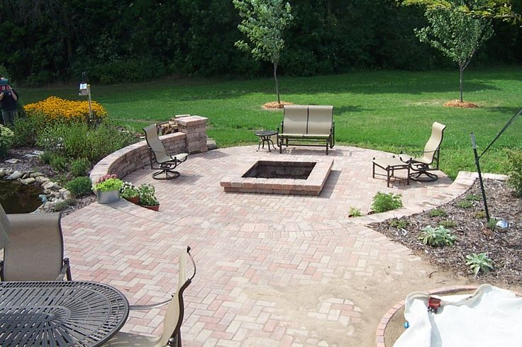 Backyard square fire pit and seating wall. The Vande Hey