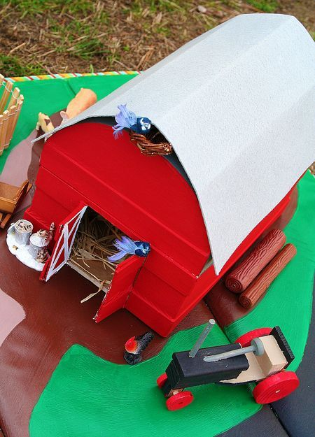 DIY barn made from a paper mache treasure trunk and stiff cardboard.  The roof opens for play time.