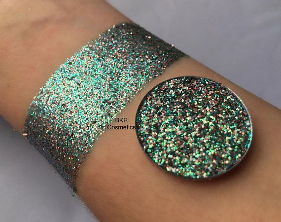 Holographic fairy dust pressed glitter eyeshadow, cosmetic grade glitter, glitter eyeshadow, eyeshadow make up Shade: fairy dust Pictures show glitter swatches with and without a flash. All photos are unedited. Do you love glitter make up but loose glitter is too messy or hard to work