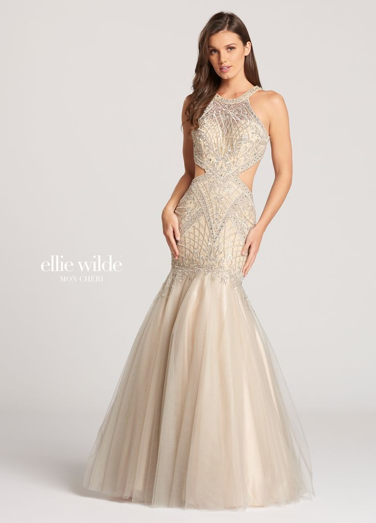 Ellie Wilde EW118157 - Sleeveless tulle and metallic embroidered lace trumpet dress with jewel neckline. Lace covered illusion panels on the upper back create a small keyhole at upper back and large keyhole at lower back that wraps around waist to create a cutout effect on the front. Lace designs on the bodice and upper skirt accentuate the curves of the bust and fitted hips. Lace overlays the top of the tulle skirt where it flares out at the knees into a full skirt with a sweep train.