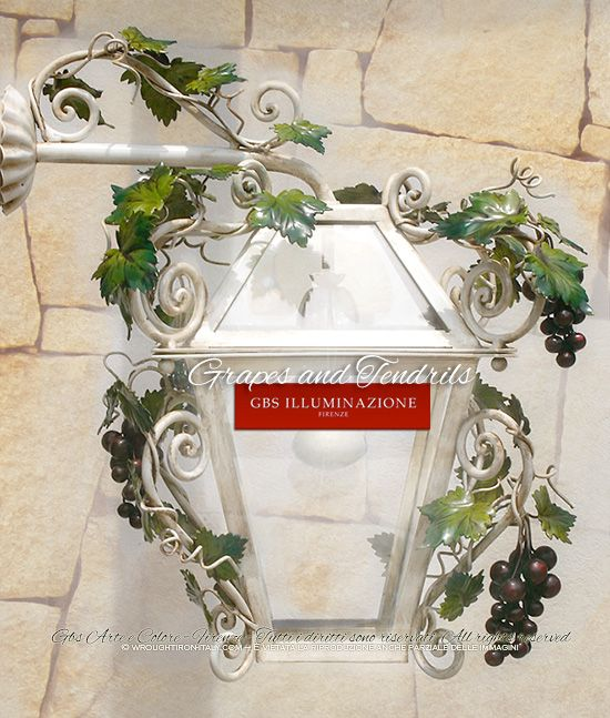 Grapes and Tendrils  Lantern with Grapes and Tendrils. Wall Lantern Sconce with arm. For indoors and outdoors. Entirely in wrought iron and hand-decorated.