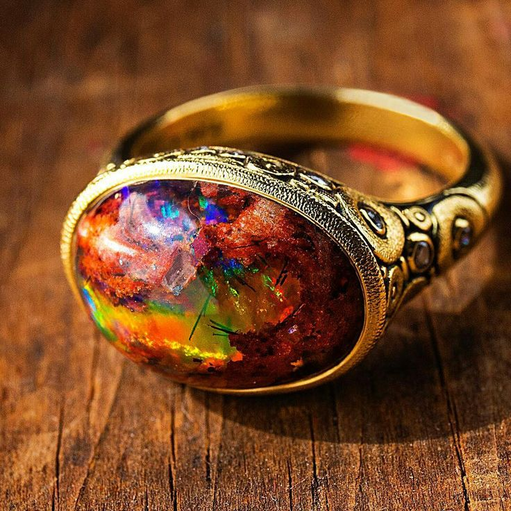 Ring with Mexican fire opal matrix