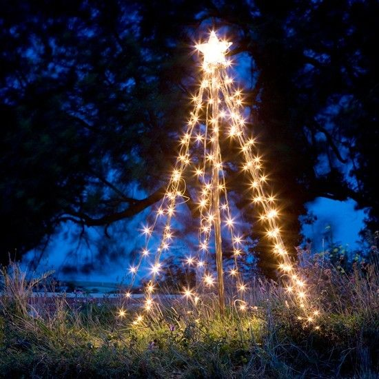 Create a magical outdoor feature by stringing fairy lights along a metal frame to create a sculptural outdoor Christmas tree.