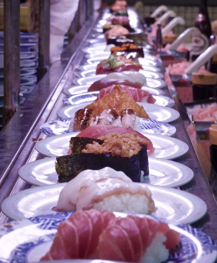 Conveyor belt sushi in Tokyo, only $1 per plate