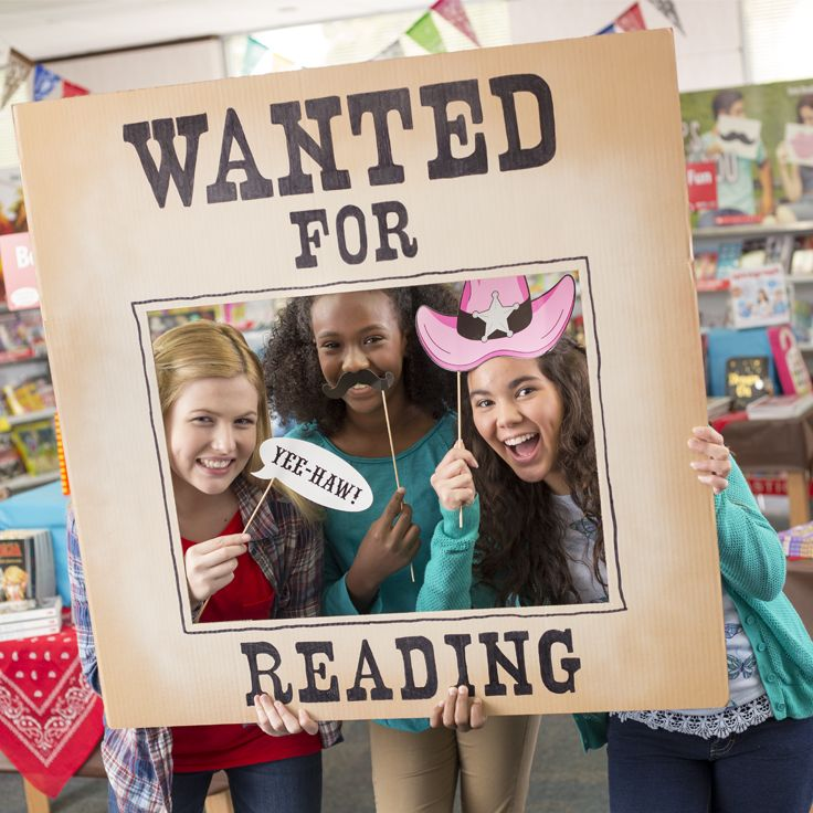 """Make a large """"Wanted for Reading"""" sign like this one and include in your selfie booth."""