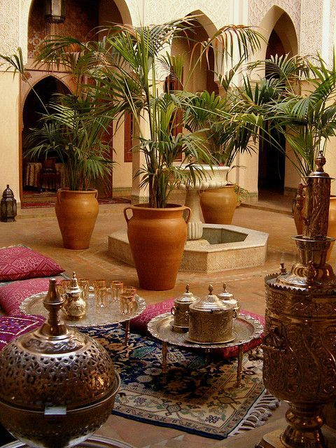 A stunning Moroccan courtyard with gorgeous Moroccan decor elements. #Moroccan #Decor #Riad #Luxury.