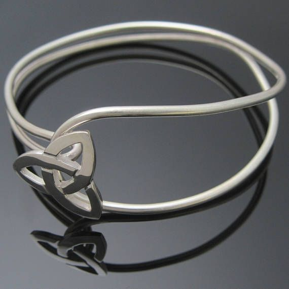 Check out this item in my Etsy shop https://www.etsy.com/ie/listing/536213853/silver-trinity-knot-bangle-celtic-bangle