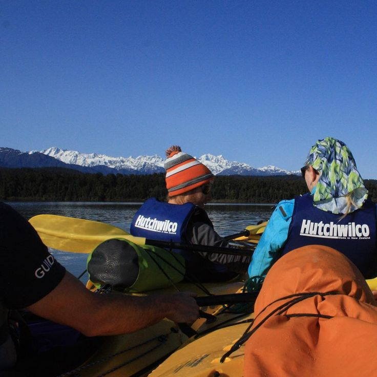 Kayaking in Okarito Lagoon, New Zealand  with the stunning southern alps in the background