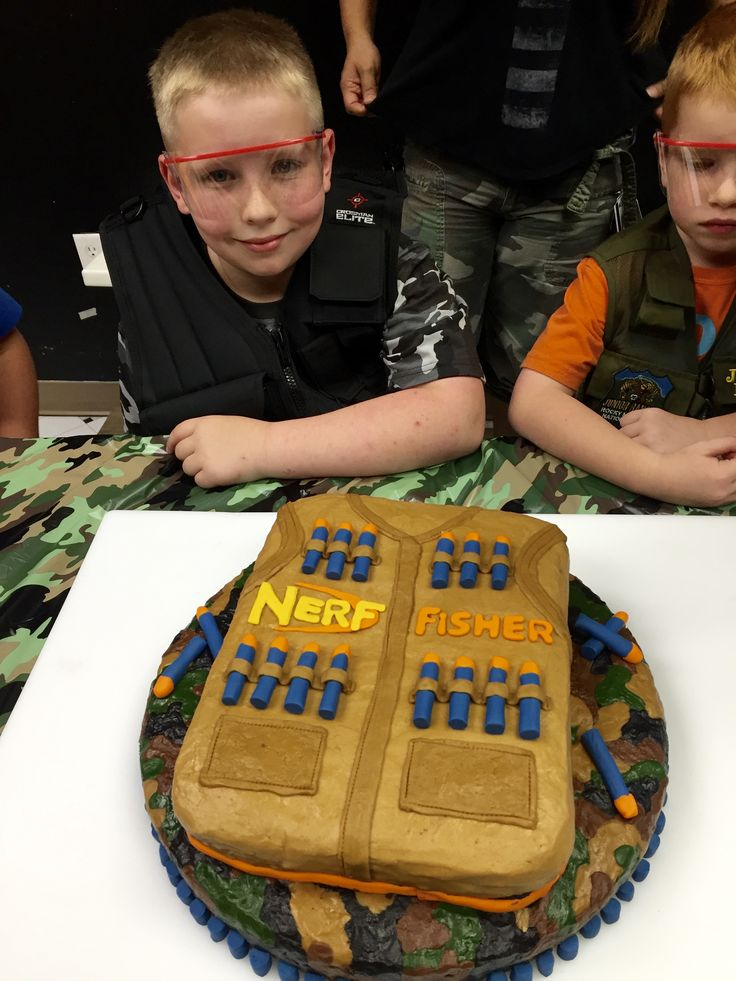 Fisher wanted hunting and Nerf.  Bottom layer done in buttercream camo and top layer in chocolate Nerf tactical vest 2016