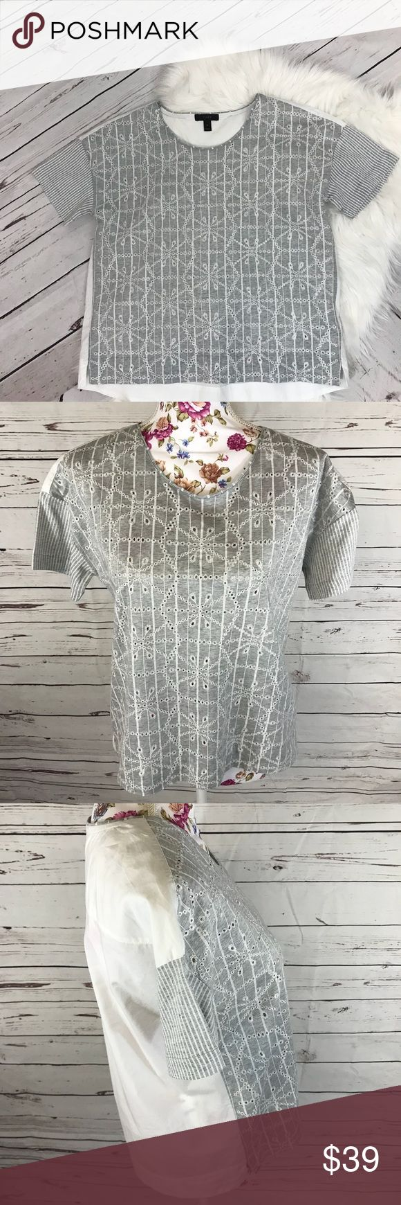 J. Crew small gray/white eyelet striped blouse J. Crew small gray/white eyelet striped blouse Size small Front is embroidered eyelets on striped background, striped sleeves, white back excellent condition - wash tag has not even been removed J. Crew Tops Blouses