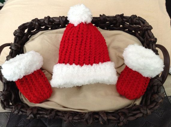 Santa Baby Hat and booties. Santa baby knit hat. Christmas Baby Shower Gift.  Soft baby yarn beanie with Pom pom and booties. Very cuddly and super soft. Red and white hat and booties, Santa baby  0-3 months Measures 6 inches tall- standard newborn size  Perfect baby shower gift or Christmas baby gift! *Request a custom order for additional sizes made to order.  Ships in ivory organza keepsake gift bag! Limited time - get your set today