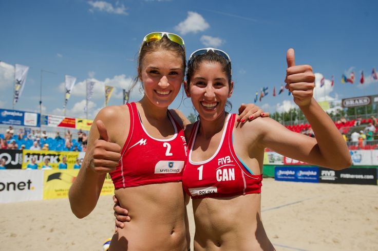 Overkill Canuck Pro Team members, Taylor Pischke and Melissa Humana-Paredes, pose for stadium shot after winning bronze in Poland at U23 World Championships!